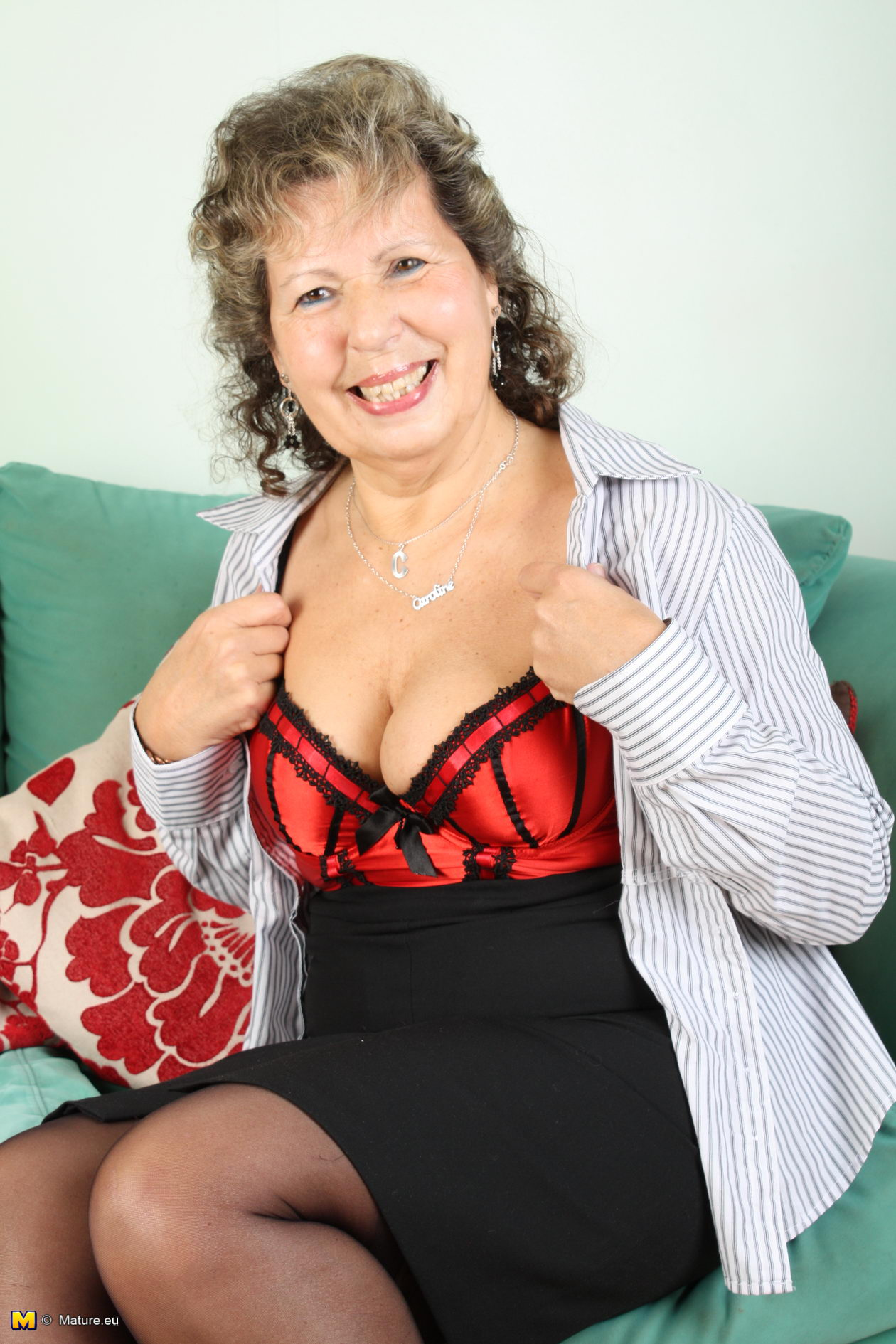 Older woman plays with pussy