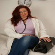 Horny mature doctor plays with her toys