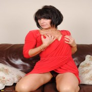 Horny MILF masturbating on the couch