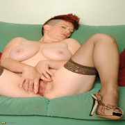 Hairy housewife masturbating on her couch