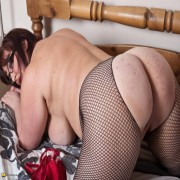 Big breasted mature slut masturbating