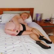 Naughty mature lady getting wet on her bed