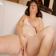 Naughty housewife playing in the bathtub
