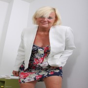 Naughty blonde housewife playing on the bed