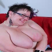 Big Breasted British mature lady fooling around