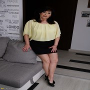 Naughty chubby housewife playing on her couch