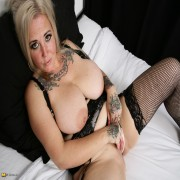 Big breasted housewife playing with her pussy