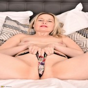 Horny British housewife getting naughty on her bed