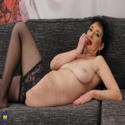 Naughty mature lady playing on her couch with herself