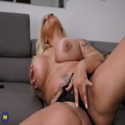 Horny blonde housewife with big tits fooling around