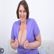 Check out those huge breasts from naughty housewife Carol Brown