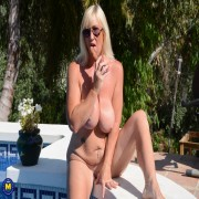 Big breasted Melody Charm plays with her pussy at the pool