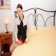 Horny Annabelle More plays with a huge dildo in bed