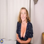 Naughty Camilla playing with her big natural tits