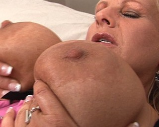 Big titted blonde mama getting naughty
