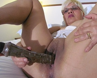 Huge dildo in her pussy and ass 7