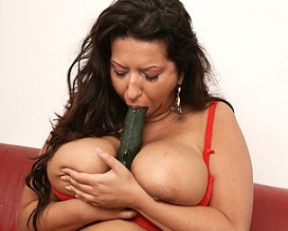 Big breasted mature slut playing with her food