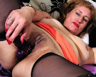 Naughty mature Naomi loves to get wet