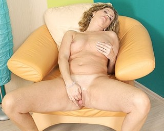 This horny housewife goes wet on her chair