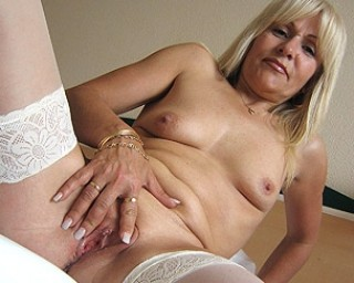 Omaseks Emilia is one hot mature nympho who loves to play with herself