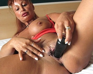 Mature mature This mature nympho slut loves to het wet on her toys