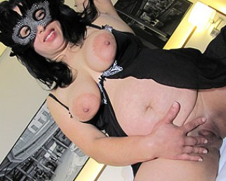 This masked mature slut loves to play with her toy