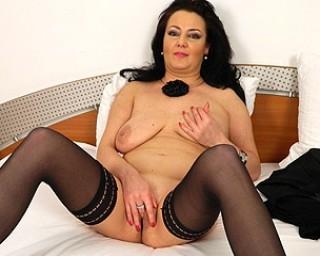 Naughty mature slut masturbating all alone