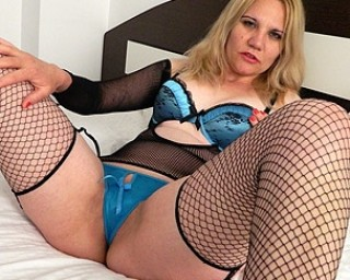 Horny blonde housewife playing with her pussy