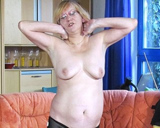 Mature German slut masturbating on the couch