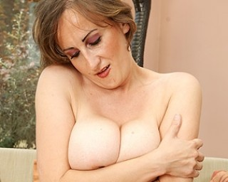 Big breasted mature slut playing alone
