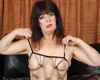 Horny British houswife having fun with her dildo