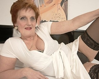 Sexy grandma playing with her pussy