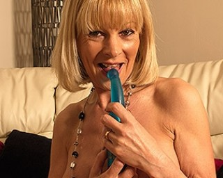 Naughty blonde British housewife getting wet