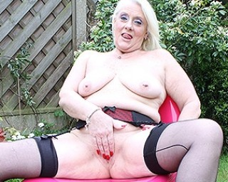 Naughty British housewife playing in the garden