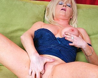 Naughty blonde housewife masturbating on the couch