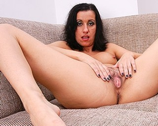 Horny housewife masturbating on her couch