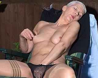 Naughty British mature lady masturbating in her garden