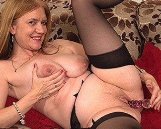 Big breasted British housewife playing with her shaved pussy