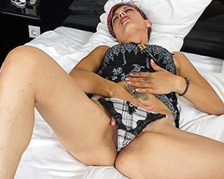 Naughty housewife playing with herself after reading a book