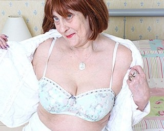 Naughty British mature lady playing with her wet pussy