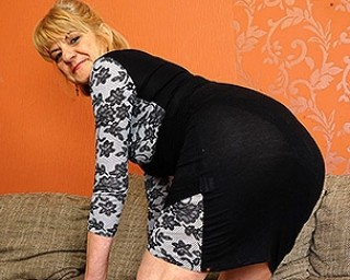 Naughty mature lady masturbating on the couch