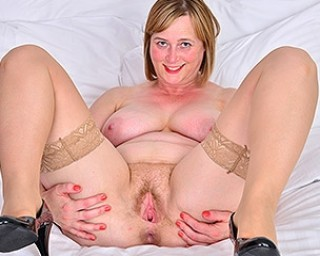 Horny British mom playing with her unshaved pussy