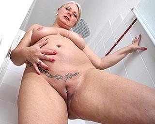 Naughty German housewife playing in her bathroom