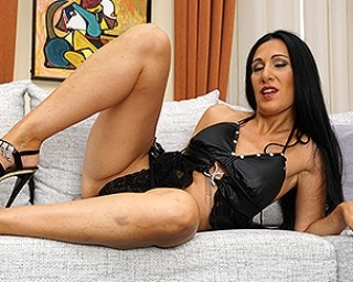 Naughty shaved housewife playing with her pussy