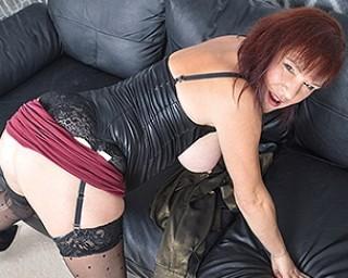 Horny British mature slut masturbating on the couch