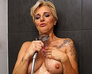 This housewife loves playing with her pussy in the shower