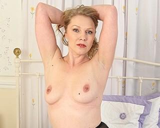 Naughty British MILF playing with herself