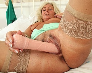 Sexy UK housewife playing with her toy