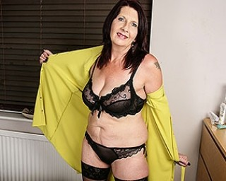 Horny British housewife shows her knockers and gets her pussy wet
