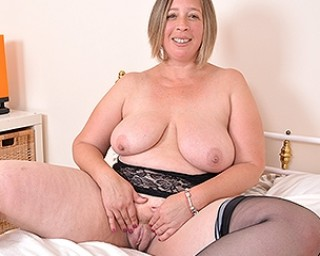Chubby British housewife getting wet and wild